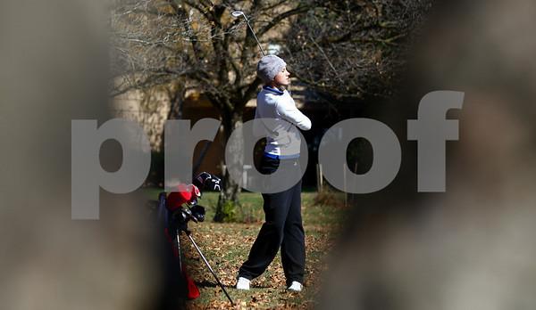 Kyle Bursaw – kbursaw@shawmedia.com<br /> <br /> Genoa-Kingston's Andrea Strohmaier takes a shot on the second hole of the Oak Club in Genoa, Ill. on Monday, Oct. 8, 2012.