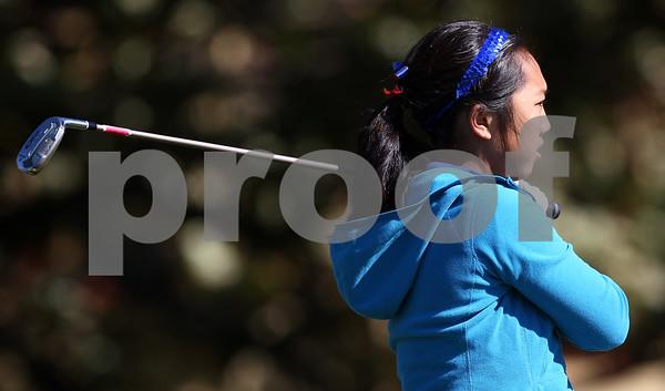 Kyle Bursaw – kbursaw@shawmedia.com<br /> <br /> Genoa-Kingston's Katie Thurlby tees off on the second hole of The Oak Club in Genoa, Ill. on Monday, Oct. 8, 2012.