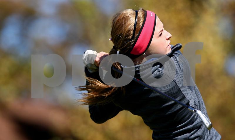 Kyle Bursaw – kbursaw@shawmedia.com<br /> <br /> Genoa-Kingston's Emily Wakeley tees off on the second hole of The Oak Club in Genoa, Ill. on Monday, Oct. 8, 2012.