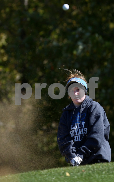Kyle Bursaw – kbursaw@shawmedia.com<br /> <br /> Hinckley-Big Rock's Caitlyn Fecht hits out of the sand onto the third green at the Oak Club in Genoa, Ill. on Monday, Oct. 8, 2012.