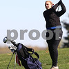 Kyle Bursaw – kbursaw@shawmedia.com<br /> <br /> Genoa-Kingston's Gabby Galauner takes a shot on the first hole of the Oak Club in Genoa, Ill. on Monday, Oct. 8, 2012.