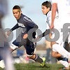 Kyle Bursaw – kbursaw@shawmedia.com<br /> <br /> Hiawatha's Ed Canchola dribbles near <br /> Chicagoland Jewish High School's goal in the first half of the Class 1A Genoa-Kingston Regional Semifinal at Genoa-Kingston High School on Wednesday, Oct. 10, 2012.