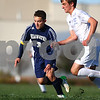 Kyle Bursaw – kbursaw@shawmedia.com<br /> <br /> Hiawatha's Marek Mlodzianowski and Chicagoland Jewish's Aaron Zell chase after ball the first half of the Class 1A Genoa-Kingston Regional Semifinal at Genoa-Kingston High School on Wednesday, Oct. 10, 2012.
