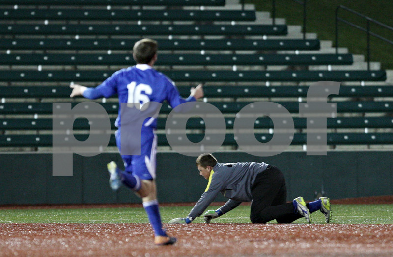 Rob Winner – rwinner@shawmedia.com<br /> <br /> Alton Marquette's Aaron Mattix-Wand (16) celebrates as a ball gets past Hinckley-Big Rock goalkeeper Jason Bohannon (right) in the second half during the Class 1A State semifinal in Normal, Ill., Friday, Oct. 26, 2012. Alton Marquette defeated H-BR, 4-3.
