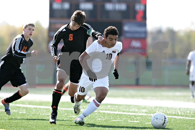 Rob Winner – rwinner@shawmedia.com<br /> <br /> DeKalb's Andrew Stratton (8) and Huntley's Niko Mihalopoulos (10) chase after a ball in the second half during the Class 3A DeKalb Regional final Saturday, Oct. 20, 2012. Huntley defeated DeKalb, 3-1.