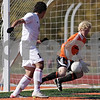 Rob Winner – rwinner@shawmedia.com<br /> <br /> DeKalb goalkeeper Cully Hicks (22) makes a save but gives up a rebound which led to Huntley's first goal in the first half during the Class 3A DeKalb Regional final Saturday, Oct. 20, 2012. Huntley defeated DeKalb, 3-1.