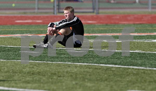 Rob Winner – rwinner@shawmedia.com<br /> <br /> DeKalb's Nick Sablich sits on the field after DeKalb fell to Huntley, 3-1, during the Class 3A DeKalb Regional final Saturday, Oct. 20, 2012.