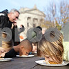 Rob Winner – rwinner@shawmedia.com<br /> <br /> Mira Quimby (left), 10, and her sister Kaci Quimby, 8, both of Crystal Lake, compete in the Sycamore Pumpkin Festival pie eating contest Saturday, Oct. 27, 2012.