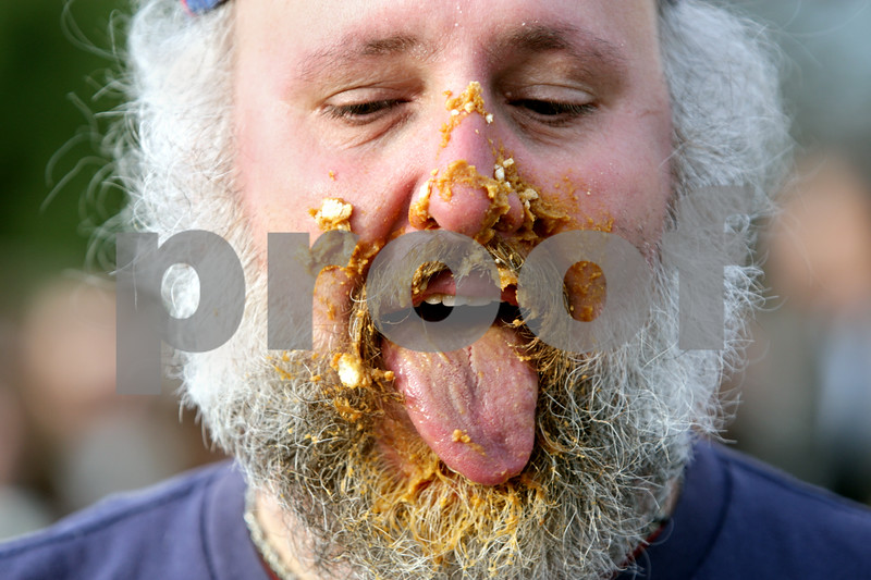 Rob Winner – rwinner@shawmedia.com<br /> <br /> Sycamore resident DJ Kurtzman tries to clean his beard with his tongue after winning a pie eating contest at the Sycamore Pumpkin Festival Saturday, Oct. 27, 2012.