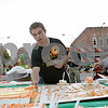 Rob Winner – rwinner@shawmedia.com<br /> <br /> The 2012 Sycamore Pumpkin Festival Grand Marshal Austin Culton cuts cake for guests at the festival in downtown Sycamore Wednesday evening.<br /> <br /> Wednesday, Oct. 24, 2012