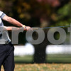 Kyle Bursaw – kbursaw@shawmedia.com<br /> <br /> Kaneland's Matt Yonkovich hits, taking a piece of the course with him, on the fourth hole of Sycamore Golf Course on Tuesday, Oct. 2, 2012.