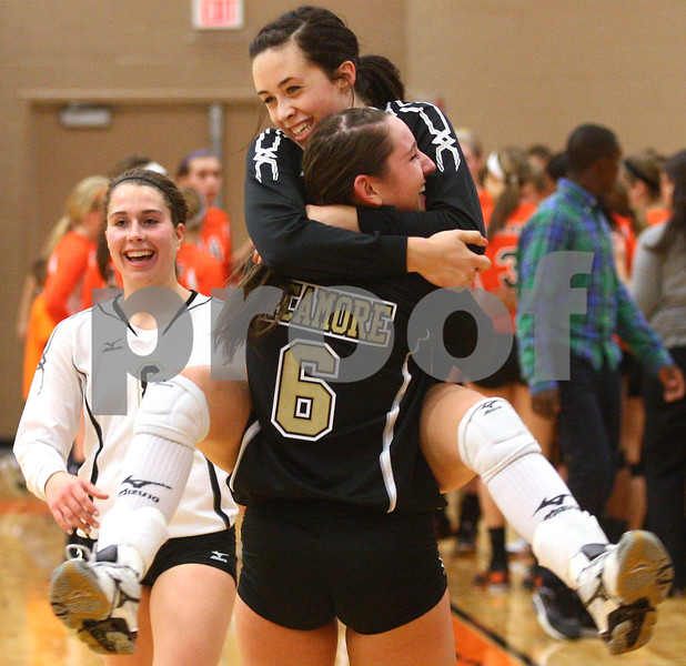 Kyle Bursaw – kbursaw@shawmedia.com<br /> <br /> Sycamore's Emily Young jumps into the arms of teammate Hannah Knox after Sycamore defeated DeKalb 28-26, 25-21 at DeKalb High School on Thursday, Oct. 4, 2012. The Spartans lost the five previous matches against the Barbs.