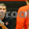Kyle Bursaw – kbursaw@shawmedia.com<br /> <br /> DeKalb coach Ben Fisher gives instructions to player Madison Lord (right) before a play in the first game against Sycamore. Sycamore defeated DeKalb 28-26, 25-21 at DeKalb High School on Thursday, Oct. 4, 2012