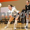 Kyle Bursaw – kbursaw@shawmedia.com<br /> <br /> Sycamore's Christina Dailey digs the ball as Emily Young looks on during the second game against DeKalb. Sycamore defeated DeKalb 28-26, 25-21 at DeKalb High School on Thursday, Oct. 4, 2012