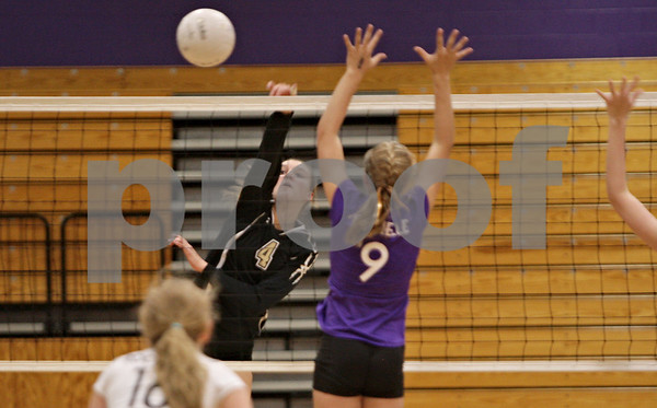 Rob Winner – rwinner@shawmedia.com<br /> <br /> Sycamore's Ratasha Garbes (4) has a kill to end the Spartans first game against Rochelle Thursday, Oct. 18, 2012. Sycamore defeated Rochelle, 25-14 and 25-14.