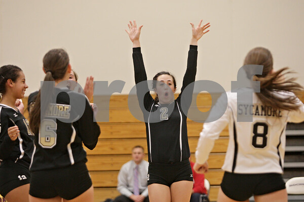 Rob Winner – rwinner@shawmedia.com<br /> <br /> Sycamore's Emily Young (2) celebrates a Spartans point during the second game in Rochelle Thursday, Oct. 18, 2012. Sycamore defeated Rochelle, 25-14 and 25-14.