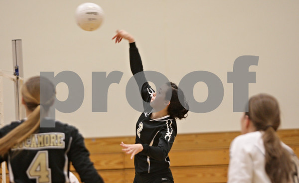Rob Winner – rwinner@shawmedia.com<br /> <br /> Sycamore's Emily Young (2) goes up for a ball during the second game in Rochelle Thursday, Oct. 18, 2012. Sycamore defeated Rochelle, 25-14 and 25-14.
