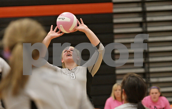 Rob Winner – rwinner@shawmedia.com<br /> <br /> Kaneland's Ashley Prost sets a ball during the third game in DeKalb Tuesday, Oct. 9, 2012. Kaneland defeated DeKalb, 25-20, 29-31 and 25-20.