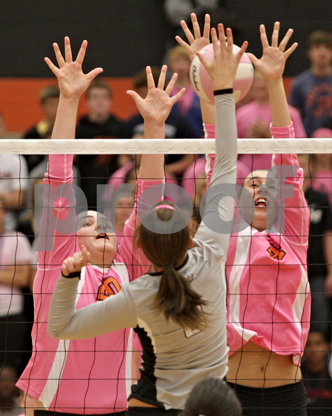 Rob Winner – rwinner@shawmedia.com<br /> <br /> Kaneland's Julia Golbeck (center) has her hit blocked by DeKalb's Courtney Wagner (right) as Madison Lord (left) assists on the play during the second game in DeKalb Tuesday, Oct. 9, 2012. Kaneland defeated DeKalb, 25-20, 29-31 and 25-20.