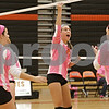 Rob Winner – rwinner@shawmedia.com<br /> <br /> DeKalb's Courtney Wagner (14) celebrates a Barbs' point during the second game in DeKalb Tuesday, Oct. 9, 2012. Kaneland defeated DeKalb, 25-20, 29-31 and 25-20.