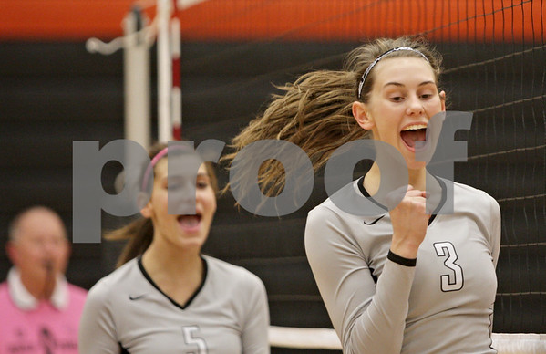 Rob Winner – rwinner@shawmedia.com<br /> <br /> Kaneland's Ellie Dunn (3) celebrates after a kill during the first game in DeKalb Tuesday, Oct. 9, 2012. Kaneland defeated DeKalb, 25-20, 29-31 and 25-20.