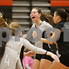 Rob Winner – rwinner@shawmedia.com<br /> <br /> Kaneland's Ellie Dunn (3) celebrates with her teammates after the Knights score the final point during the third game in DeKalb Tuesday, Oct. 9, 2012. Kaneland defeated DeKalb, 25-20, 29-31 and 25-20.