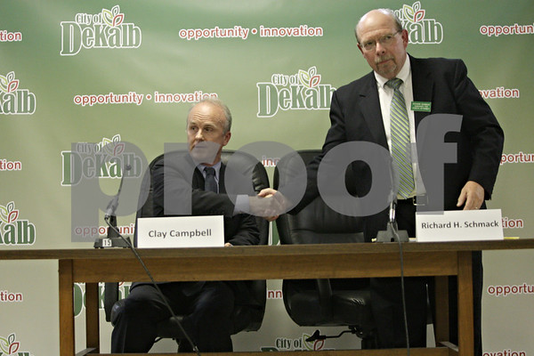 Rob Winner – rwinner@shawmedia.com<br /> <br /> Republican Clay Campbell (left) and Democrat Richard Schmack shake hands before speaking at the League of Women Voters of Dekalb County Candidates' Night at DeKalb City Hall Wednesday, Oct. 17, 2012. Campbell and Schmack are running for state's attorney.