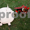 Rob Winner – rwinner@shawmedia.com<br /> <br /> Abby Hardesty, 2, of DeKalb, takes a closer look at one of the pumpkin entries on the lawn outside the DeKalb County Courthouse in Sycamore at the Sycamore Pumpkin Festival Wednesday evening.<br /> <br /> Wednesday, Oct. 24, 2012