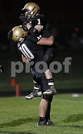 Rob Winner – rwinner@shawmedia.com<br /> <br /> Sycamore tight end Jacob Davis (10) lifts up running back Austin Culton (1) after Culton's fourth rushing touchdown of the game late in the fourth quarter during a Class 5A playoff game in Sycamore Saturday, Oct. 27, 2012. Sycamore defeated Chicago King, 35-13.