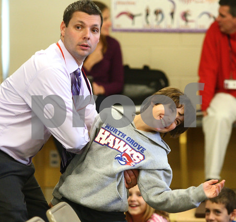 Kyle Bursaw – kbursaw@shawmedia.com<br /> <br /> North Grove Elementary Principal Ryan Janisch pretends to push fourth-grader Syler Larson while role-playing a situation as part of an anti-bullying presentation for fourth and fifth grade students on Thursday, Oct. 11, 2012.