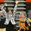 Kyle Bursaw – kbursaw@shawmedia.com<br /> <br /> Sycamore coach Debbie Klock celebrates along with an assistant coach, Ratasha Garbes (foreground) and Mattie Hayes (12) as Sycamore defeats DeKalb 28-26, 25-21at DeKalb High School on Thursday, Oct. 4, 2012. The Spartans lost the five previous matches against the Barbs.