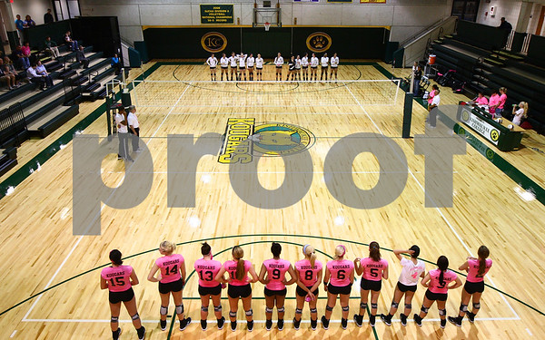 Kyle Bursaw – kbursaw@shawmedia.com<br /> <br /> Kishwaukee College volleyball players (bottom) stand on the line for introductions in their renovated gymnasium before the game against Black Hawk College on Wednesday, Oct. 3, 2012.