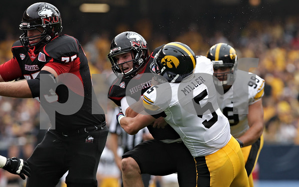 Rob Winner – rwinner@shawmedia.com<br /> <br /> Northern Illinois quarterback Jordan Lynch is tackled by Iowa defensive back Tanner Miller (5) after a 7-yard gain during the first quarter of their game at Soldier Field in Chicago, Ill., Saturday, Sept. 1, 2012. Iowa defeated NIU, 18-17.