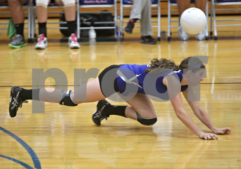 Rob Winner – rwinner@shawmedia.com<br /> <br /> Hinckley-Big Rock's Caitlin Flanigan is unable to control a ball during the second game against Kaneland  Tuesday night in Hinckley. Kaneland defeated H-BR, 25-13 and 25-11.