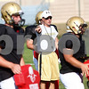 Kyle Bursaw – kbursaw@shawmedia.com<br /> <br /> Sycamore coach Joe Ryan talks to his offense while standing amongst a defensive squad during practice on Tuesday, Sept. 4, 2012.