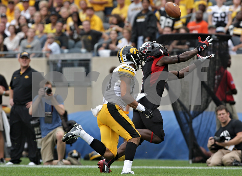Rob Winner – rwinner@shawmedia.com<br /> <br /> Northern Illinois wide receiver Martel Moore (1) reaches out for a ball before hauling in the pass for a 25-yard yard gain during the second at Soldier Field in Chicago, Ill., Saturday, Sept. 1, 2012. Iowa defeated NIU, 18-17.
