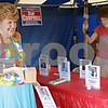 Rob Winner – rwinner@shawmedia.com<br /> <br /> Kathy Busch (left) and her daughter, Shaina Busch, both of Sandwich, share a laugh while setting up the DeKalb County Republicans' tent at the Sandwich Fairgrounds on Tuesday afternoon.