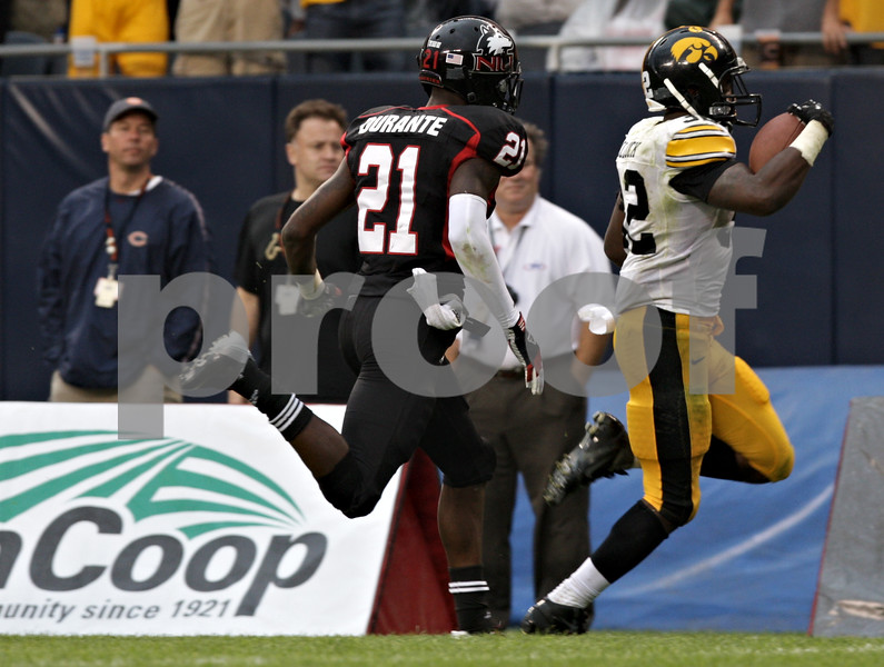Rob Winner – rwinner@shawmedia.com<br /> <br /> Northern Illinois safety Dechane Durante (21) is unable to catch Iowa running back Damon Bullock (right) who broke away for a 23-yard touchdown run during the fourth quarter at Soldier Field in Chicago, Ill., Saturday, Sept. 1, 2012. Iowa defeated NIU, 18-17.
