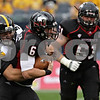 Rob Winner – rwinner@shawmedia.com<br /> <br /> Iowa defensive lineman Joe Gaglione (99) sacks Northern Illinois quarterback Jordan Lynch (6) for a 1-yard loss during the third quarter of their game at Soldier Field in Chicago, Ill., Saturday, Sept. 1, 2012. Iowa defeated NIU, 18-17.
