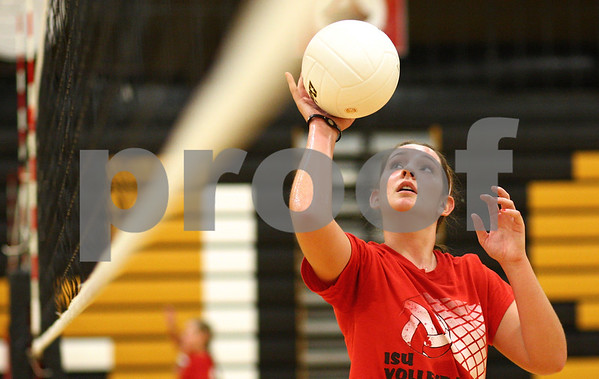 Kyle Bursaw – kbursaw@shawmedia.com<br /> <br /> Sycamore volleyball player Hannah Knox catches a ball from a teammates dig during practice on Tuesday, Sept. 4, 2012.