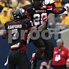 Rob Winner – rwinner@shawmedia.com<br /> <br /> Northern Illinois' Perez Ashford (7)congratulates running back Keith Harris, Jr. (20) after his 7-yard touchdown run to start the second quarter at Soldier Field in Chicago, Ill., Saturday, Sept. 1, 2012. Iowa defeated NIU, 18-17.
