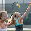 Kyle Bursaw – kbursaw@shawmedia.com<br /> <br /> Caitlin Mereness works on her serve during a drill at practice on Wednesday, Sept. 5, 2012.