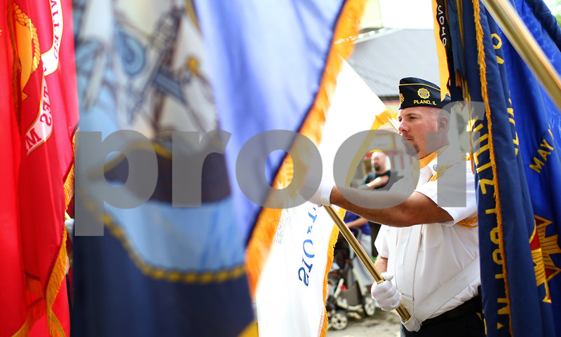 Kyle Bursaw – kbursaw@shawmedia.com<br /> <br /> Dennis Whitmer, a Marine Corps veteran, displays the colors with his colleagues as the national anthem is played on Wednesday, Sept. 5, 2012.