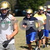 Kyle Bursaw – kbursaw@shawmedia.com<br /> <br /> Dakotah Quimby leads a group of teammates in a warmup at practice on Thursday, Sept. 6, 2012.