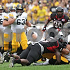 Rob Winner – rwinner@shawmedia.com<br /> <br /> Northern Illinois linebacker Jamaal Bass (6) puts a hit on Iowa tight end C.J. Fiedorowicz (86) during the first quarter of their game at Soldier Field in Chicago, Ill., Saturday, Sept. 1, 2012. Iowa defeated NIU, 18-17.