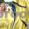 Kyle Bursaw – kbursaw@shawmedia.com<br /> <br /> Jessie Hintzsche, 17, performs with the Renegade color-guard during a small parade at the Sandwich Fair on Wednesday, Sept. 5, 2012.