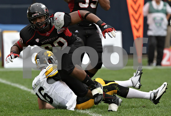 Rob Winner – rwinner@shawmedia.com<br /> <br /> Northern Illinois defensive end Alan Baxter (90) reacts after sacking Iowa quarterback James Vandenberg (16) for a 9-yard loss during the first quarter of their game at Soldier Field in Chicago, Ill., Saturday, Sept. 1, 2012. Iowa defeated NIU, 18-17.
