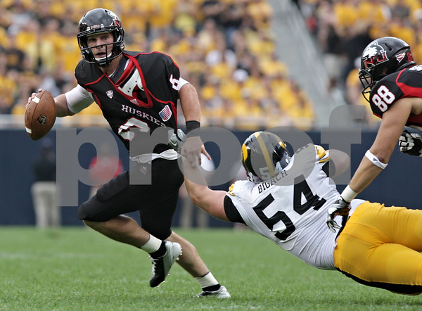 Rob Winner – rwinner@shawmedia.com<br /> <br /> Northern Illinois quarterback Jordan Lynch (6) escapes from the grasp of Iowa defensive lineman Steve Bigach (54) during the second quarter of their game at Soldier Field in Chicago, Ill., Saturday, Sept. 1, 2012. Iowa defeated NIU, 18-17.