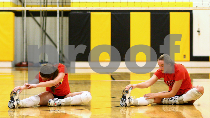 Kyle Bursaw – kbursaw@shawmedia.com<br /> <br /> Sycamore volleyball players Christina Dailey (left) and Ratasha Garbes stretch out near the start of practice on Tuesday, Sept. 4, 2012.