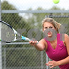 Kyle Bursaw – kbursaw@shawmedia.com<br /> <br /> Sycamore's Alexa Farris returns a ball to Angelina Ye during practice on Wednesday, Sept. 5, 2012.